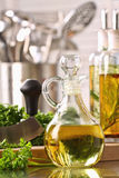 Bottle of olive oil and fresh parsley Stock Photography