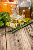 Bottle of olive oil. With fresh parsleyl and chives Royalty Free Stock Photography