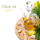 Bottle of olive oil, garlic, spices and fresh herbs, isolated. On white Stock Photography