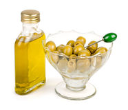 Bottle of olive oil with green olives watered with oil Royalty Free Stock Image