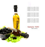 A bottle of olive oil with herbs Stock Images