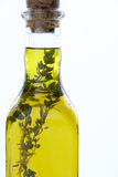 Bottle Of Olive Oil With Herbs Stock Image
