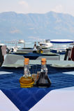 Bottle of olive oil and italian balsamic vinegar on blue tablecl Royalty Free Stock Images