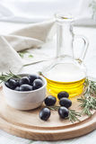 Bottle of olive oil and marinated black olives. Royalty Free Stock Photography