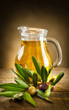 Bottle of olive oil and an olive branch Royalty Free Stock Image