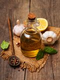 Bottle with olive oil. Olive oil with  green basil and  garlic on a table Stock Photography