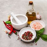 Bottle with olive oil. Olive oil with  spices and   garlic on a table Stock Images