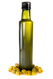 Bottle of olive oil with olives Stock Image