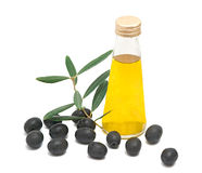 Bottle of olive oil and olives. Isolated on white background Royalty Free Stock Images