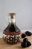 Bottle of olive oil and olives Stock Images
