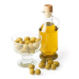Bottle of olive oil and olives isolated on white Stock Photos