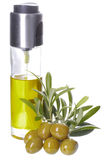 Bottle of olive oil, olives and  leaves Royalty Free Stock Photos