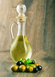 Bottle with olive oil and olives. Royalty Free Stock Photo