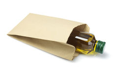 Bottle Of Olive Oil  in Paper Bag Royalty Free Stock Photography