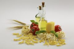 Bottle of olive oil and pasta Stock Photography