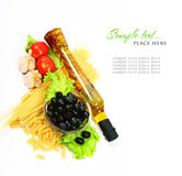 A bottle of olive oil with pasta and black olives. Isolated on a white background Royalty Free Stock Images