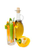 The bottle of olive oil with raw vegetables Stock Photography
