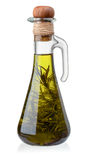 Bottle of olive oil with rosemary royalty free stock photos