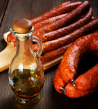 Bottle of olive oil and smoked sausage Royalty Free Stock Photos