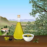 Bottle of olive oil on the table Royalty Free Stock Image