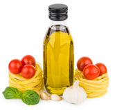 Bottle of olive oil, tagliatelle with tomatoes, garlic and basil Stock Photography