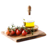 Bottle of olive oil and tomatoes Royalty Free Stock Photo