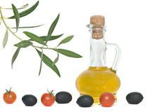 Bottle of olive oil, tomatoes, and olive fruits Royalty Free Stock Image