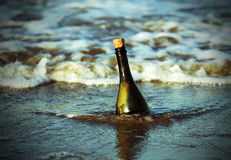 Free Bottle On The Beach With A Secret Map Royalty Free Stock Image - 75192926