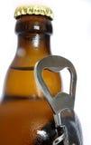 Bottle and opener Stock Image