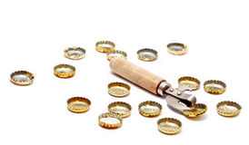Bottle opener and corks Royalty Free Stock Photos