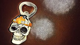 Bottle opener in the form of a Templar`s skull royalty free stock images