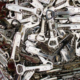 Bottle Openers. Used and new combo bottle openers heaped in a pile for sale in a used goods market stock photo