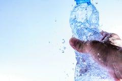 Bottle opening with water splashing isolated on white background.  royalty free stock photography