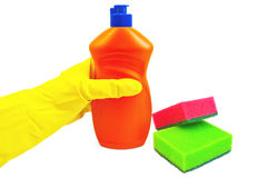 Bottle of orange with hand and sponges Stock Photography