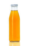 Bottle of orange juice Stock Images