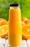 Bottle of orange juice. With fresh fruits Royalty Free Stock Image