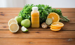 Bottle with orange juice, fruits and vegetables Royalty Free Stock Photo