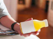 Bottle of orange juice. Hand with bottle of natural orange juice Royalty Free Stock Photography