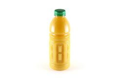 A Bottle of orange juice with pulps, isolated on w Royalty Free Stock Photo