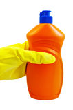 A bottle of orange in yellow-gloved hand in the Royalty Free Stock Photography