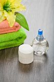 Bottle and pads adn towels with flower Royalty Free Stock Photos