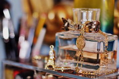 A bottle of parfume. A bittle of perfume on a dressing table Royalty Free Stock Photos