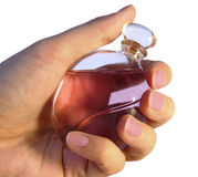 Bottle of parfume in hand Royalty Free Stock Photo