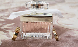 A bottle of parfume. Weding rings. Stock Image