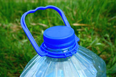 Bottle. Part of a large water bottle on the grass Stock Photography