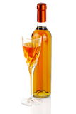 Bottle of passito wine with chalice. On white background Stock Images
