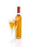 Bottle of passito wine with wine glasses. Bottle of sweet wine with wine glasses on white background Royalty Free Stock Photography