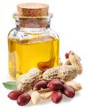 Bottle of peanut oil with nuts Royalty Free Stock Image