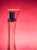 Bottle of perfume. Over pink background stock photos