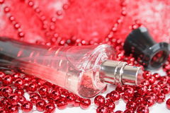 Bottle perfume. Perfumery water is decorated by a   beads Stock Photos